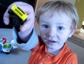 Isaac showing his car