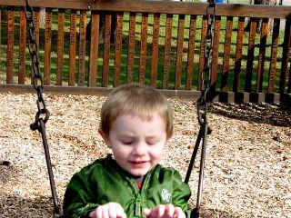 Isaac swinging age 2