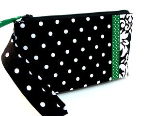 Wristlet in black and white polka dots with green ribbon