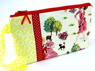 Wristlet in Fashion Park with red ribbon